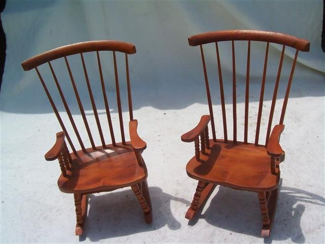 A pair of miniature doll rocking chairs
