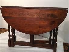 Antique Walnut gate leg drop leaf table