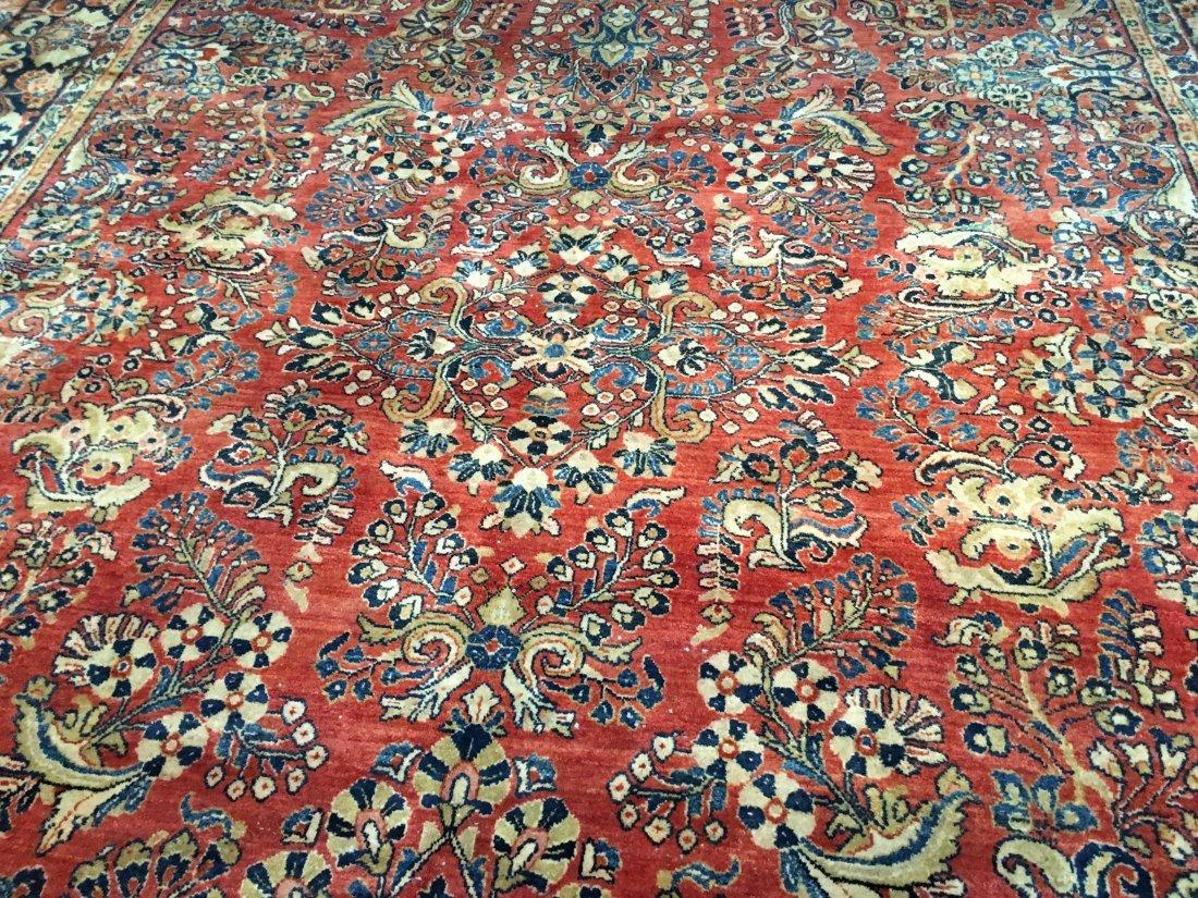 A large Antique Persian Sarouk rug