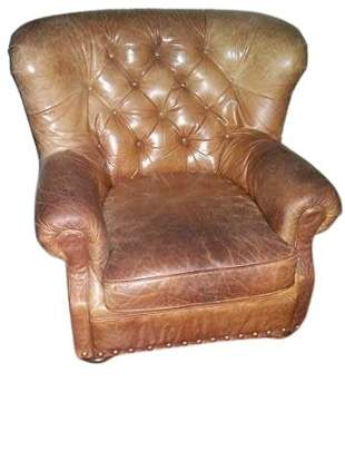 A TUFTED LEATHER WRITER'S ARMCHAIR