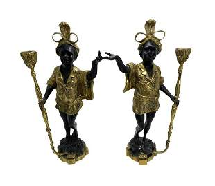 A PAIR OF GILT BRONZE BLACKAMOOR CANDLESTICK FIGURES