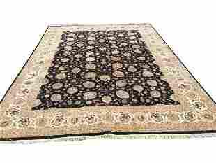 A handwoven Tabriz design rug