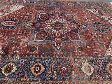 Antique Persian Heriz Serapi room size rug