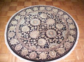 A Round handwoven Indian rug