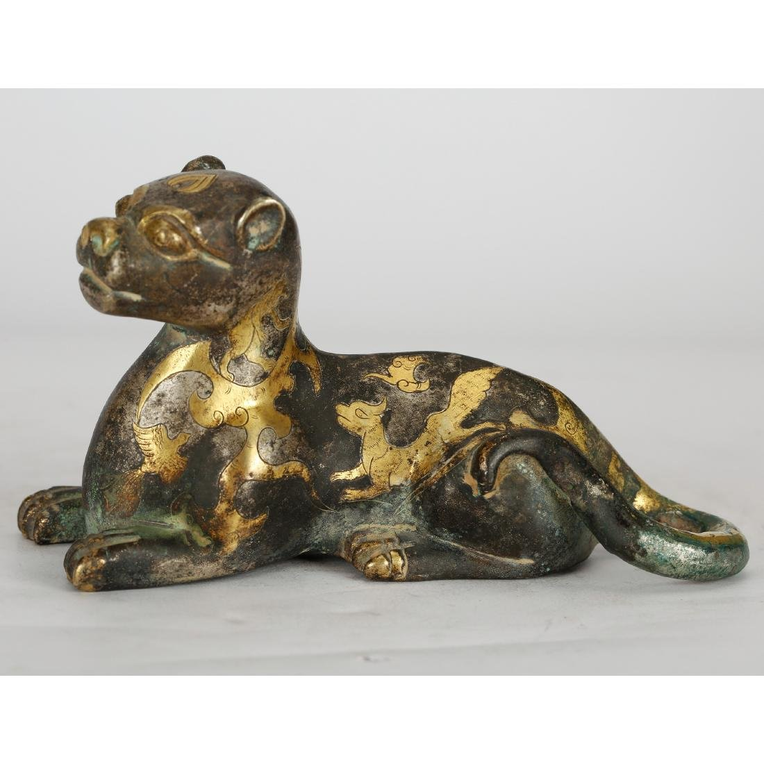 CHINESE ARCHAIC BRONZE FIGURE OF COUGAR
