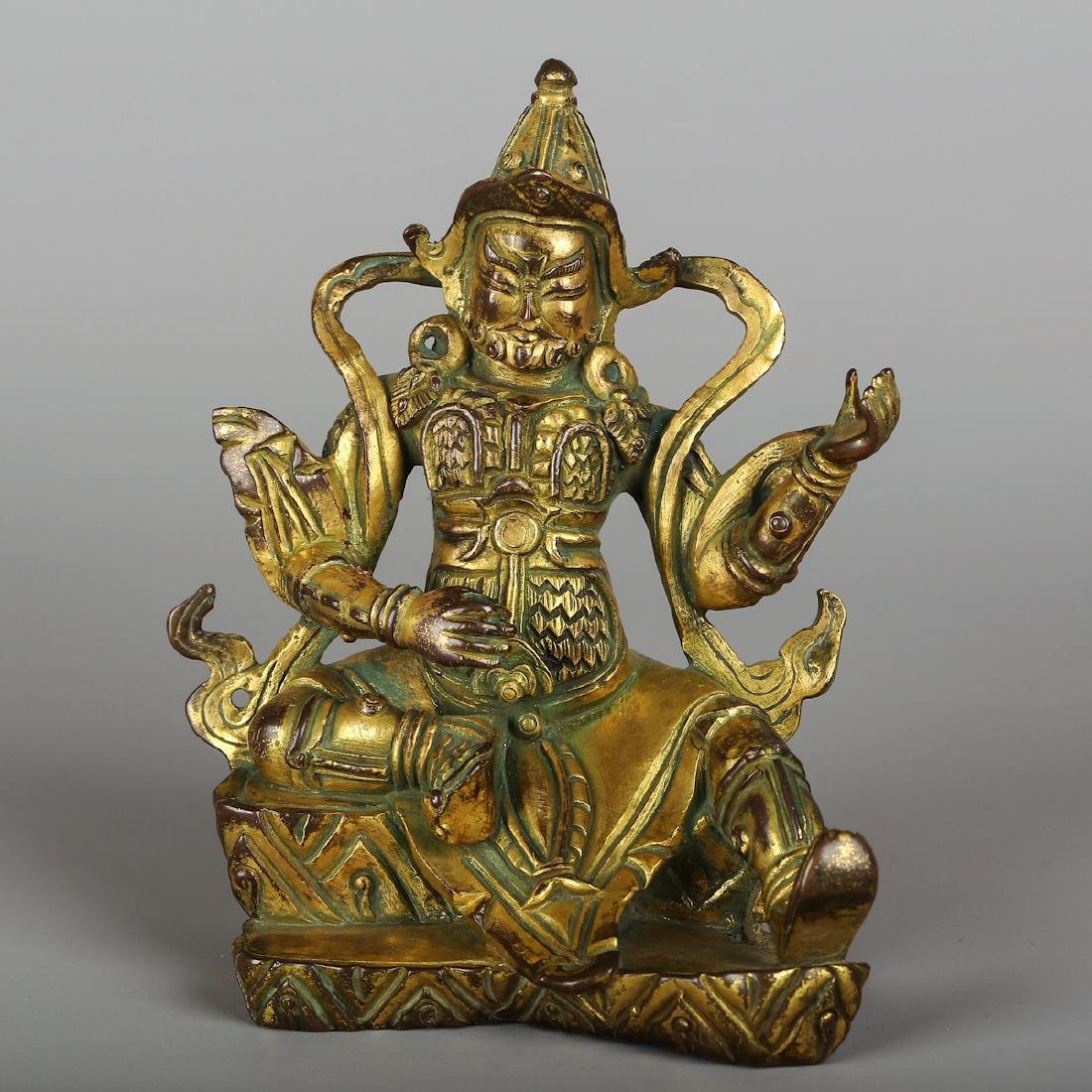 CHINESE GILT BRONZE FIGURE OF GUARDIAN