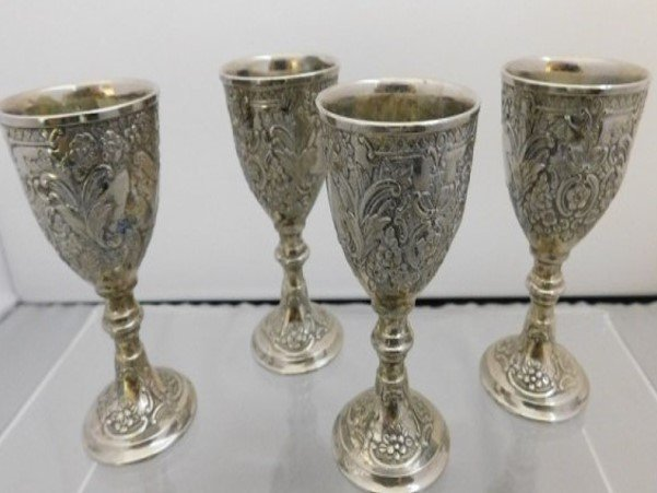 A SET OF FOUR SILVER PLATE PORT WINE GOBLETS
