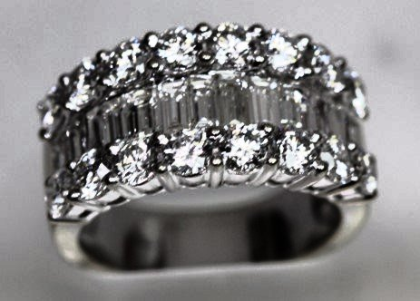 3.25 CTS OF STUNNING ROUND and BAGUETTE CUT DIAMONDS!!!