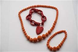 GROUP OF THREE CARVED CORAL JEWELRY