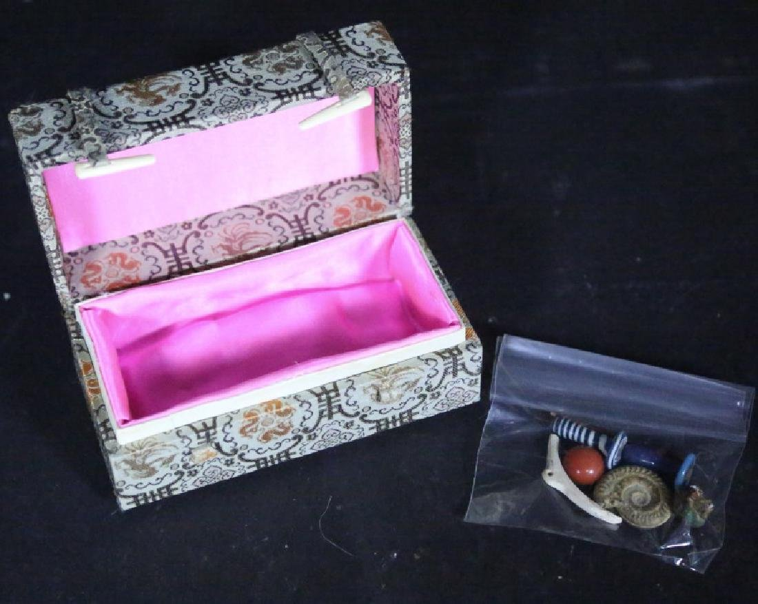 PRESENTATION BOX WITH SEVEN ANCIENT ITEMS