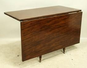 MAHOGANY DROP LEAF TABLE WITH TURNED LEGS ON BRASS