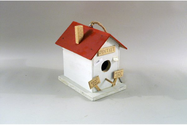 301: Humorous white and red wooden birdhouse with