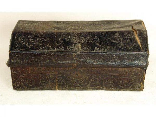 1205: Leather tooled covered chest in original conditio
