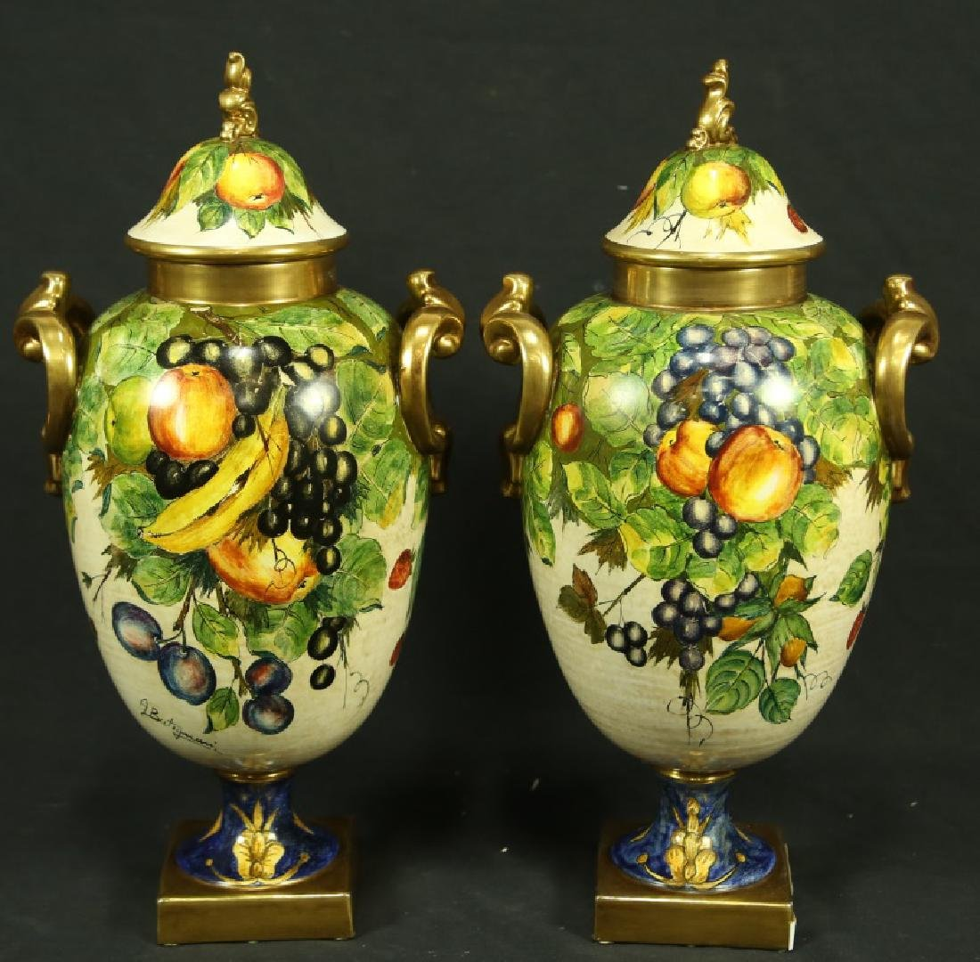 PAIR OF HAND PAINTED CERAMIC LIDDED URNS