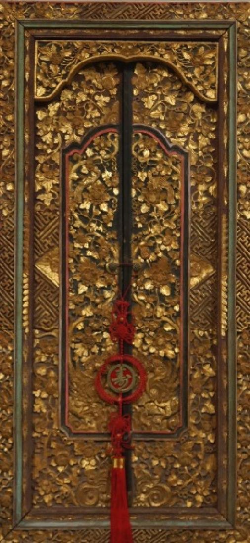 TWO ANTIQUE WOOD CARVED AND GILDED CHINESE DOORS