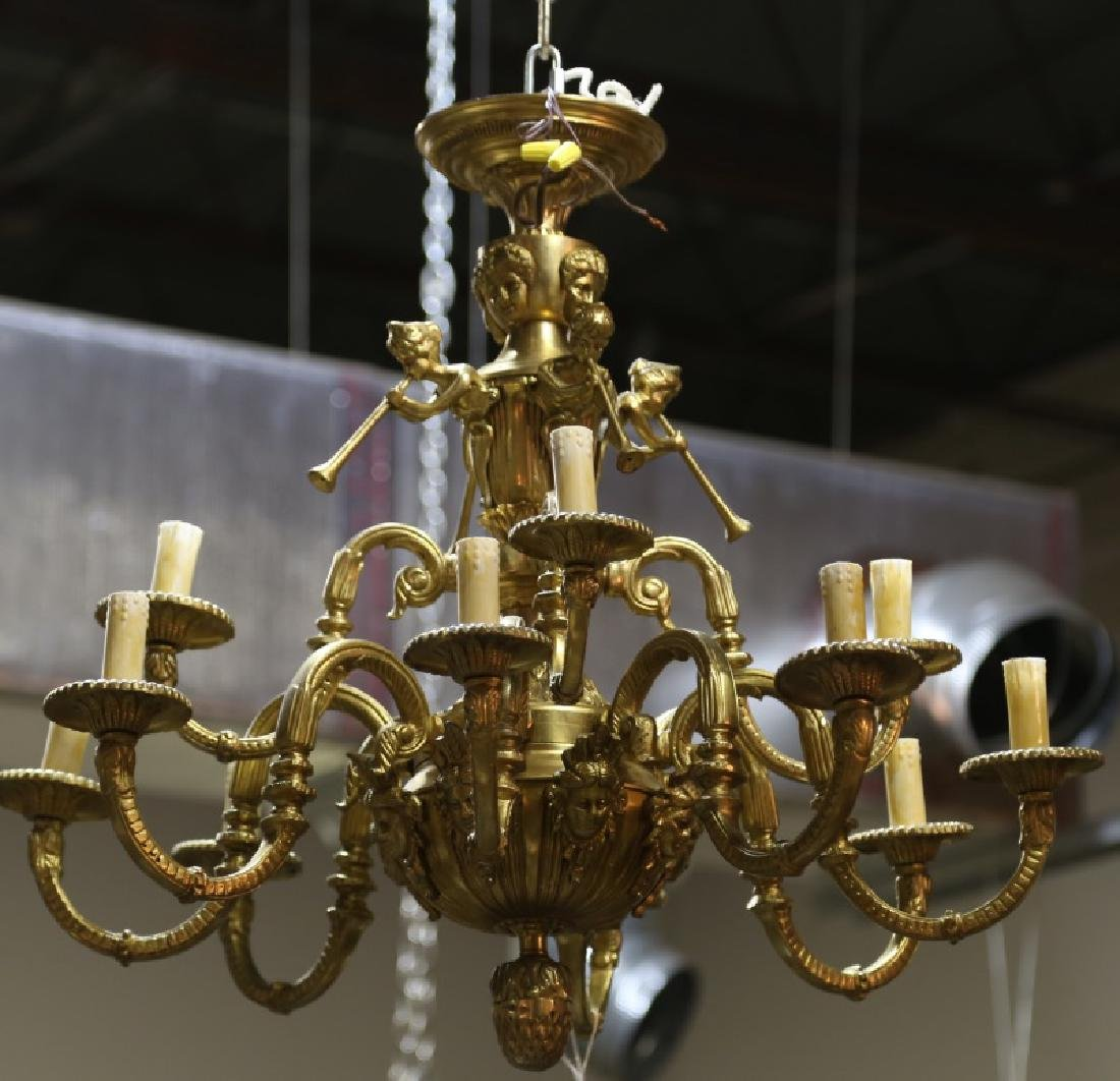 GILT BRASS TWELVE-LIGHT CHANDELIER