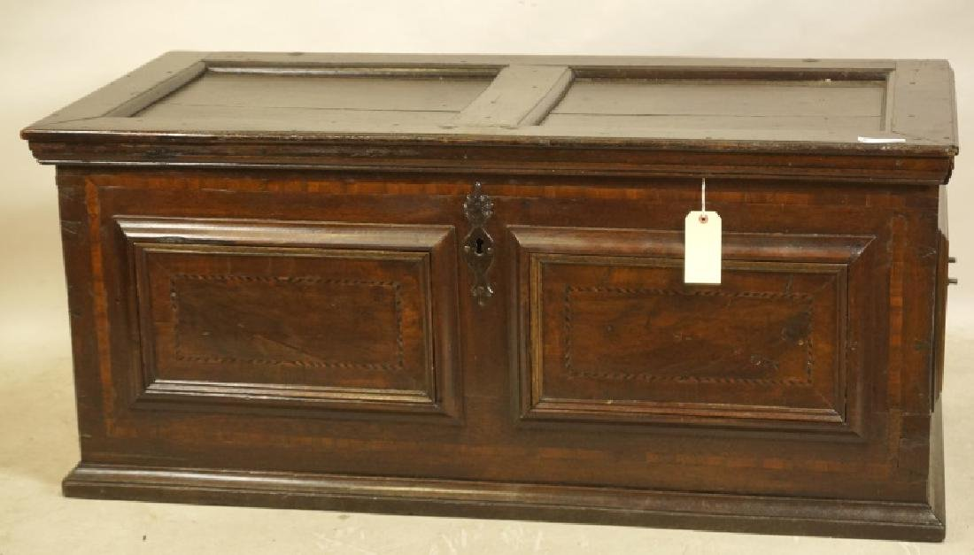 ANTIQUE PANELED WOODEN TRUNK