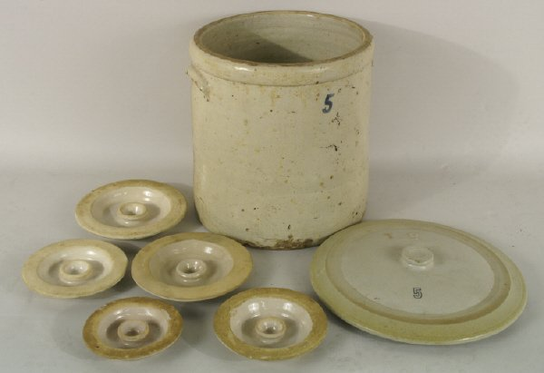19: Large ceramic container with lid and 5 churn lids