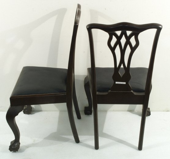 236: Antique wooden chairs with black leather upholster