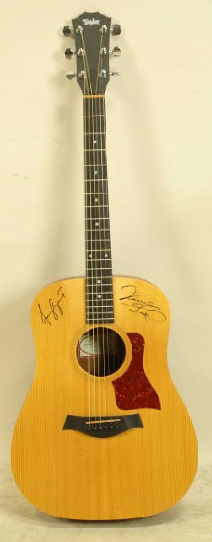 SIGNED TAYLOR BIG BABY GUITAR BY VINCE GILL