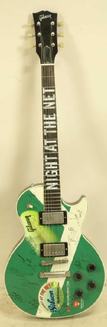 "SIGNED GIBSON GUITAR FROM ""2002 NIGHT AT THE NET""."