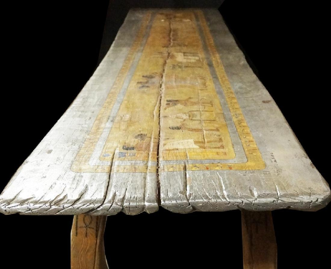 EGYPTIAN DECORATION ON ROUGH HEWN PLANK TABLE