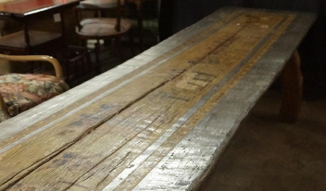 EGYPTIAN DECORATION ON ROUGH HEWN PLANK TABLE - 3