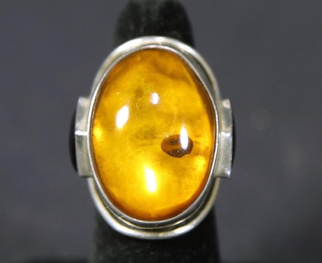 CUSTOM STERLING SILVER CABOCHON SET AMBER DOME RING