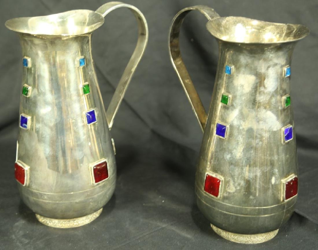 TWO SILVERPLATED METAL PITCHER