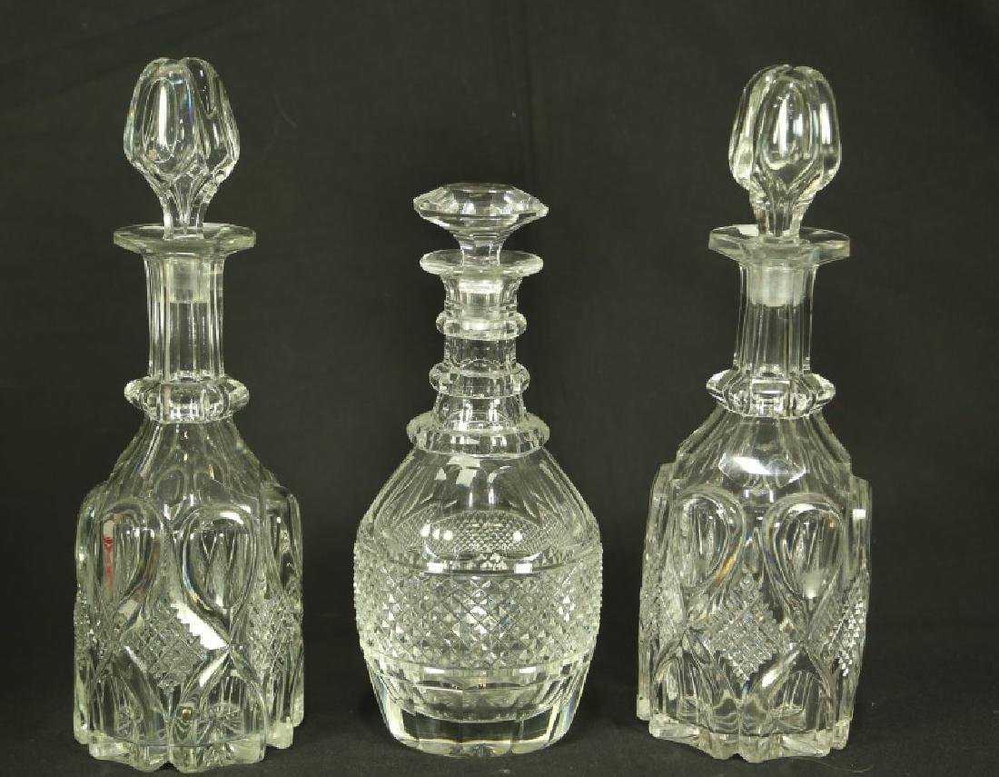 LOT OF THREE CUT CRYSTAL DECANTERS