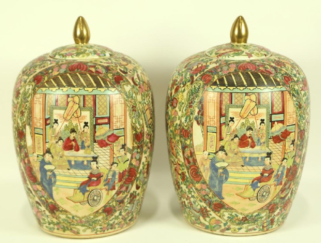 PAIR OF CHINESE FAMILLE ROSE LIDDED URNS