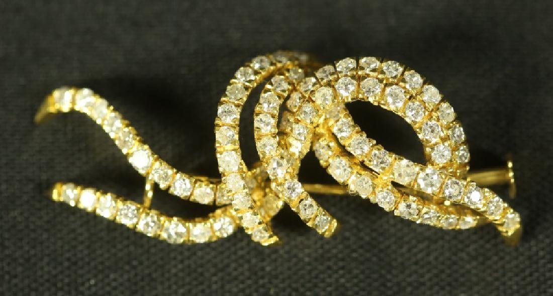 18KT YELLOW GOLD DIAMOND RIBBONS BROOCH