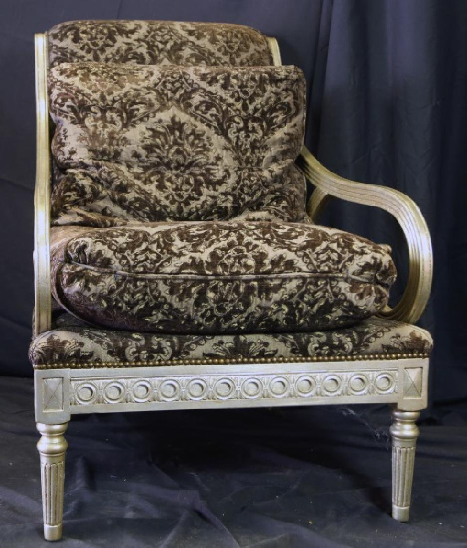SILVERLEAFED AND UPHOLSTERED SCROLL ARMCHAIR