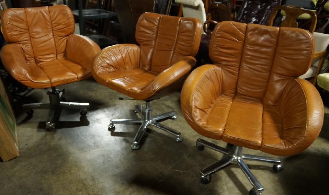 SET OF THREE BROWN LEATHER ARMCHAIRS