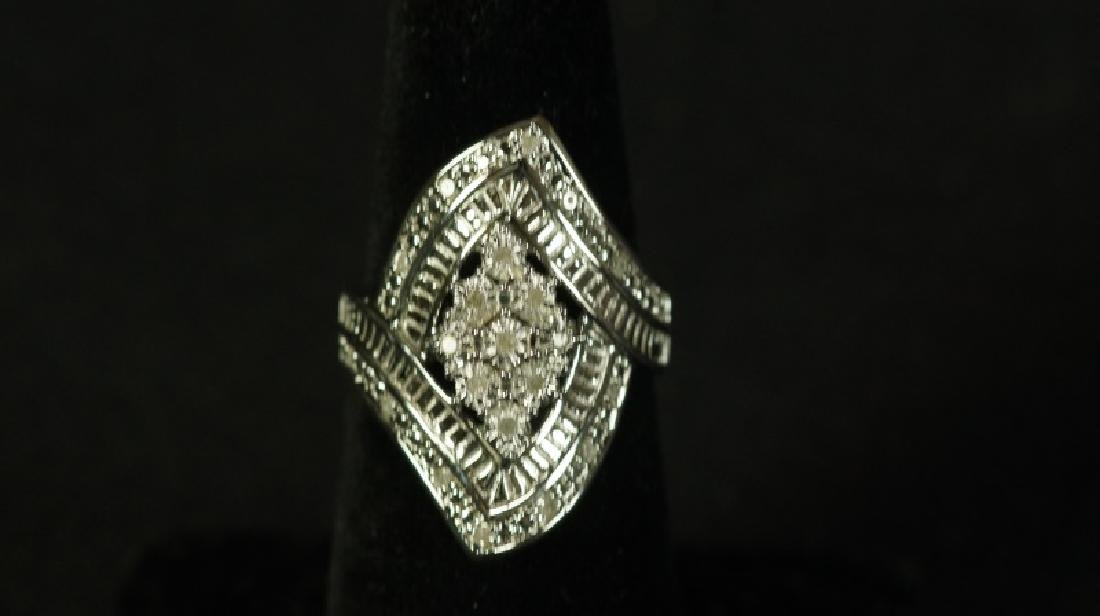 (14) LARGE MARQUISE DIAMOND RING