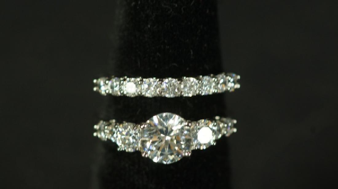 (43) 3.0 Ct. WHITE SAPPHIRE WEDDING RING