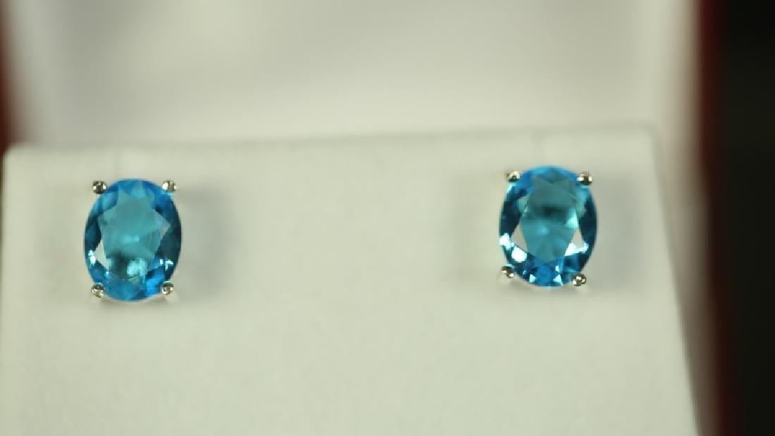 (109) 2.80 Ct. OVAL CUT BLUE TOPAZ EARRINGS