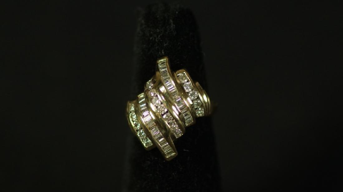 (25E) LARGE DIAMOND BAGUETTE DINER RING 14 Kt. YEL