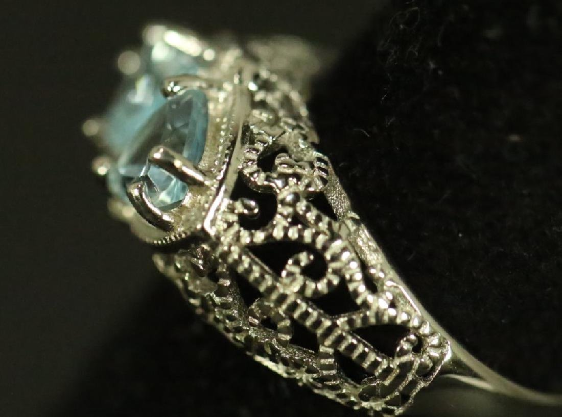 LADIES STERLING SILVER BLUE TOPAZ COCKTAIL RING. SIZE 7 - 2