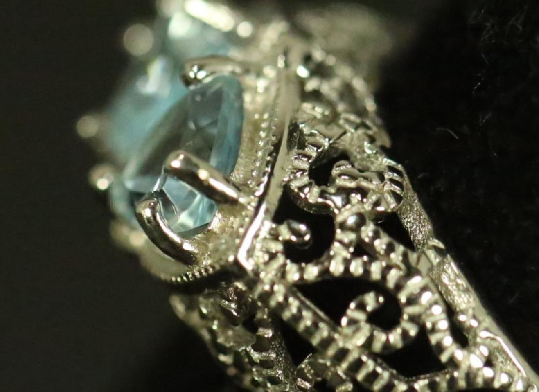 LADIES STERLING SILVER BLUE TOPAZ COCKTAIL RING. SIZE 7 - 4