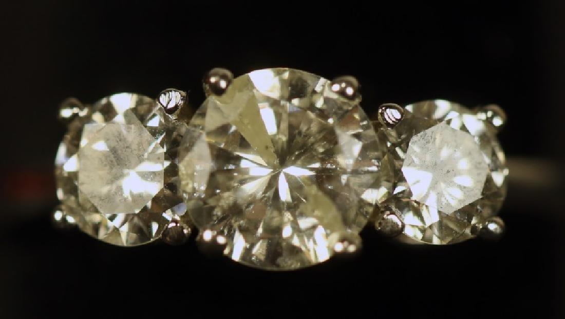 TRIPLE DIAMOND WHITE GOLD RING