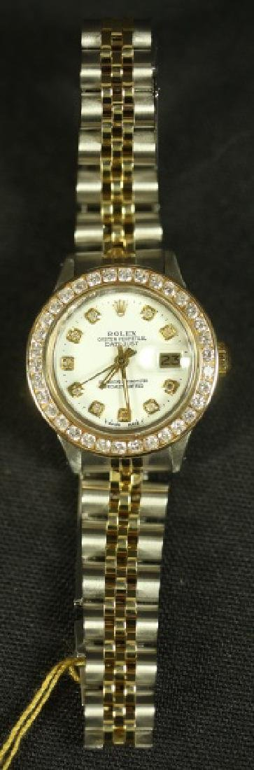 LADIES SILVER AND GOLD ROLEX WITH DIAMOND BEZEL