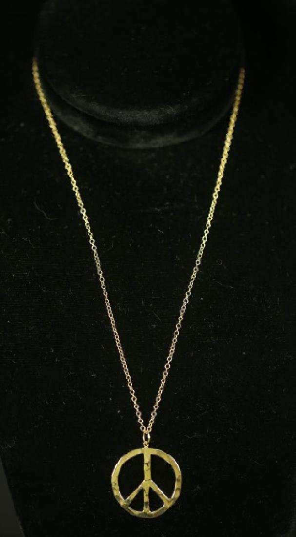 14 KT GOLD PEACE NECKLACE. 4 GRAMS T.W.
