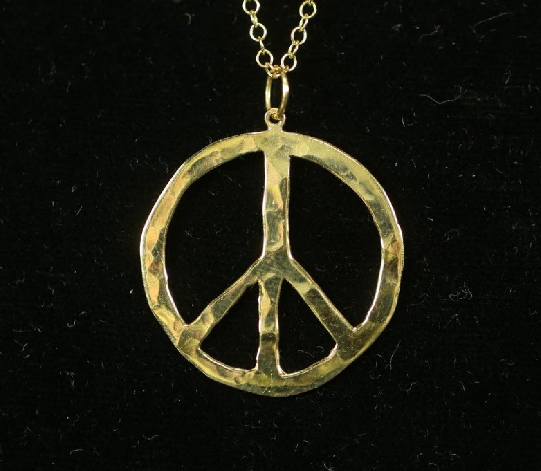 14 KT GOLD PEACE NECKLACE. 4 GRAMS T.W. - 2
