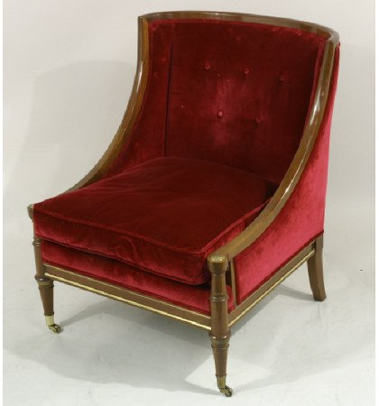 1012: Crushed red velvet lounge chair on casters