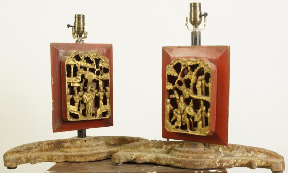 PAIR OF CARVED GILDED PANEL IRON BASE LAMPS