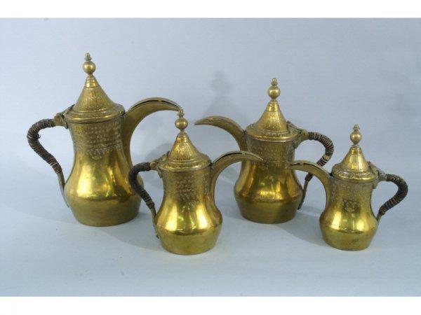 Set of 4 brass pitchers