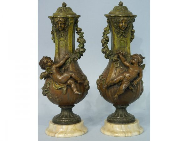 Pair of metal urns on marble bases