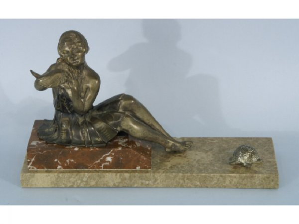 Brass art deco seated woman on marble