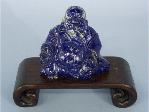 Carved lapis figure of Buddha on wood base